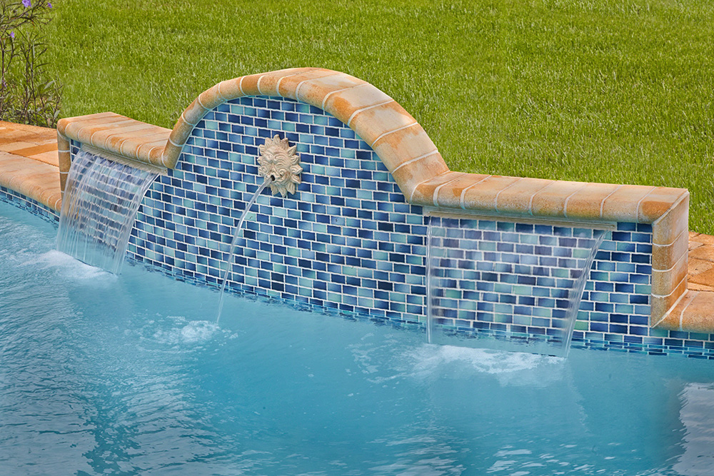 Luxury waterfall features apex pavers and pool stuart fl for Common pool design xword